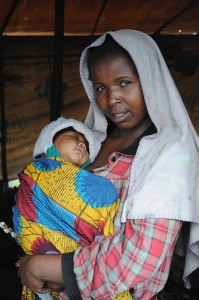 mother holding a child in Goma