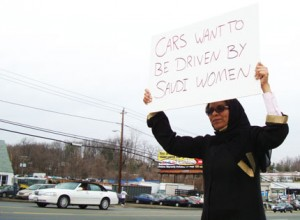 "A Saudi Woman Holds Up a Sign Saying, ""Cars Want to be Driven by Saudi Women."" Image Credit: Flickr"