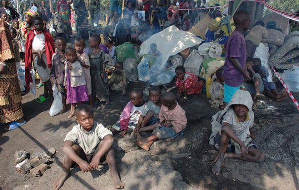 Children gather in a makeshift camp in the Democratic Republic of Congo. (Julian Harneis) Taken from original post.