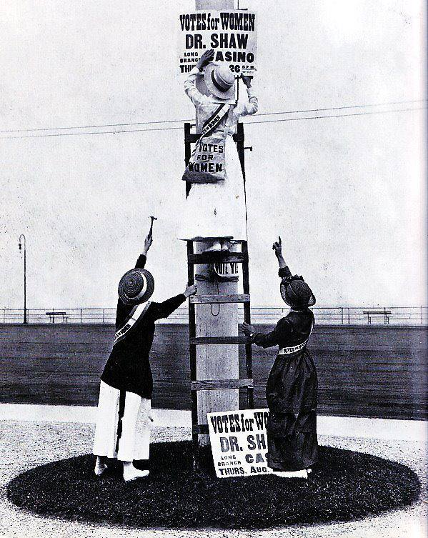 Suffrage workers putting up signs in Asbury Park earlier this year, advertising Dr. Anna Howard Shaw's speech to a meeting of the New Jersey Woman Suffrage Association at the Long Branch Casino on August 26th.