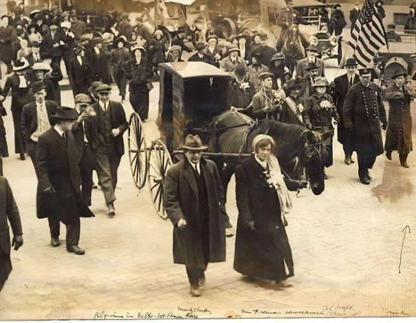 "The ""Overlea contingent"" of the suffragist ""Army of the Hudson"" arriving this morning in Baltimore. Among those in the group are Elizabeth Freeman, in front of Lausanne, the horse pulling the literature wagon. Col. Craft is just to the left of the police officer at the right of the photo"
