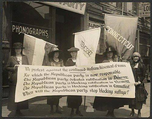A banner to be used in the picketing of the Republican Convention. From left to right: Abby Scott Baker, Florence Taylor Marsh, Sue White, Elsie Hill and Betty Gram.