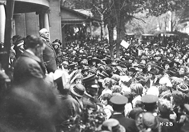 Republican Presidential nominee Warren G. Harding speaks to a crowd of supporters gathered outside his home.
