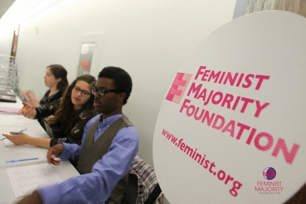 Interns Ishmael Bishop, Talia Cowen, and Nora Brodnitz helped participents sign in