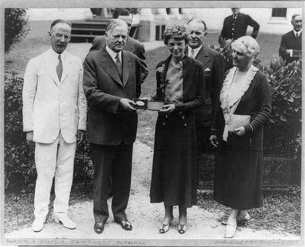 President Hoover, with whom she met today, presenting Amelia Earhart with the Gold Medal of the National Geographic Society on June 21st of this year for her Transatlantic solo flight.
