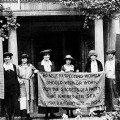 "National Woman's Party members standing in front of their headquarters three months ago, with a banner that seems as relevant now as it did during the suffrage struggle: "" 'No self respecting woman should wish or work for the success of a party that ignores her sex.' Susan B. Anthony 1872 and 1894."""