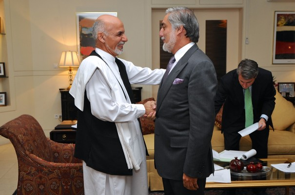 Ghani (left) and Abdullah at an earlier election discussion with Secretary of State John Kerry. via US Department of State