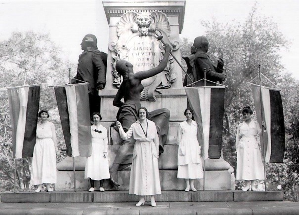 National Woman's Party demonstrators gathering at the Lafayette Monument earlier today to protest President Wilson's lack of meaningful action on lobbying the Susan B. Anthony (national woman suffrage) Amendment through Congress.