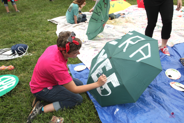 Paige McKinsey, University of Mary Washington and former FMF intern paints ERA umbrella.