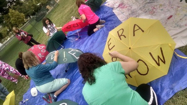 Supporters making ERA umbrellas in the rain on Saturday.