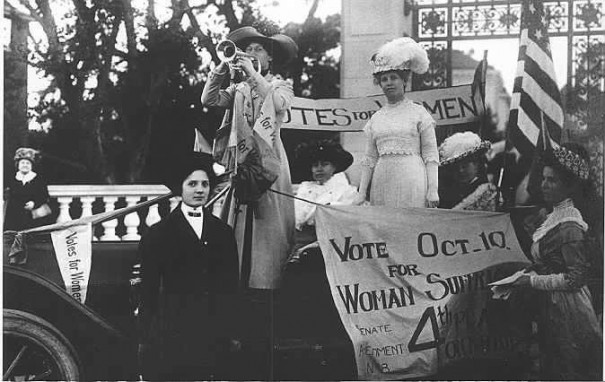 A bugler opens a recent suffrage rally as Margaret Haley, a Chicago teacher who has come to California to help the campaign, prepares to speak.
