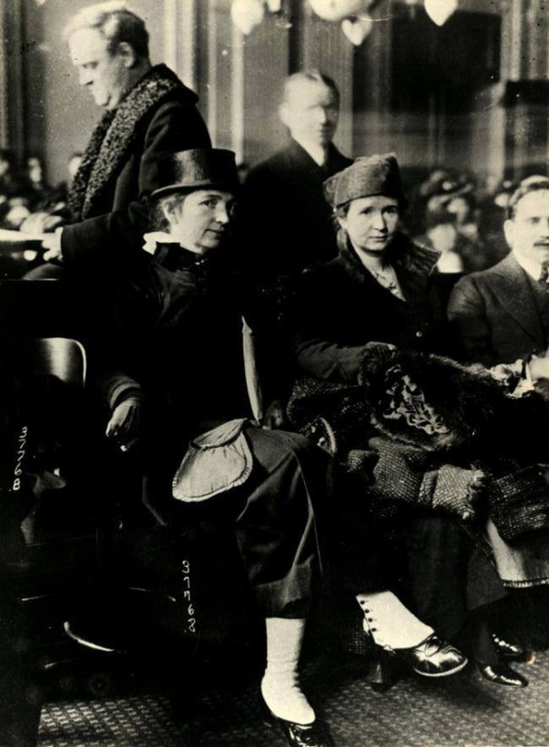 Ethel Byrne, just to the right of center, and her sister, Margaret Sanger, on the left, when Byrne was in court earlier this month being tried on the charge of disseminating birth control information.
