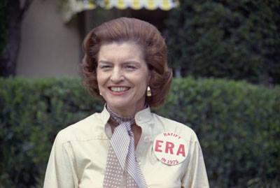 """First Lady Betty Ford wearing a large """"Ratify E.R.A. in 1975"""" button on February 26th as an honored guest of the Jackie Gleason Inverrary Classic Celebrities Golf Tournament in Hollywood, Florida."""