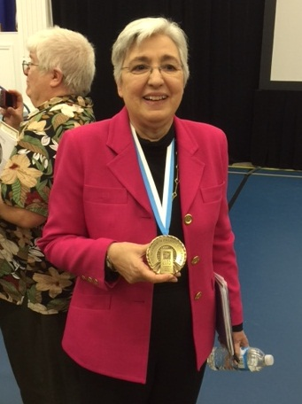 Smeal with her National Women's Hall of Fame medal